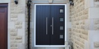 Milano composite French doors in black on cream frame with ES3 door handle and key only security locking option.