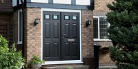 Tenby 2 French composite door in black on white frame.