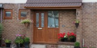 Ludlow 2 composite door in oak with Simplicity glass and integrated side panel.