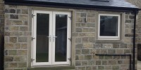 Cream on Irish Oak uPVC French doors installed in Salendine Nook.