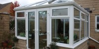 White PVCu conservatory with self-cleaning glass roof.