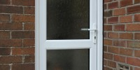 White PVCu front door with 2 obscure glass panels.