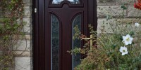 Lichfield PVCu door in Rosewood with Digital glass.