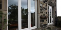 PVCu French doors with side light and cat flap in white.
