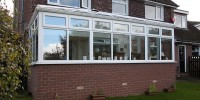 White PVCu conservatory with glass roof.