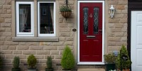 Red Ludlow composite door with Elegance glass.