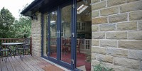 Grey on white outward opening PVCu French doors.
