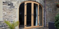 PVCu shaped French doors in Irish Oak