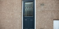 Beeston composite door in Grey with prairie glass, Holmfirth