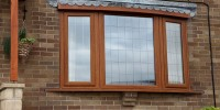 PVCu bay window in Irish Oak with square lead glass.