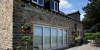 5 pane aluminium bi-fold doors in Cream installed in Brighouse.